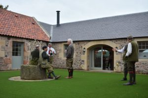Guests chatting in the courtyard at Fenton Brunt Club