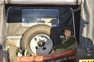Young gun relaxing in back of a Land Rover