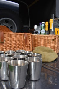 Drinks and picnic hamper close-up